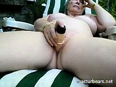 Granny Alice toying pussy in the garden
