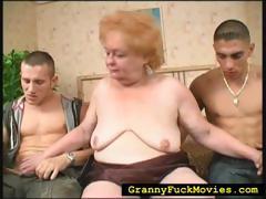 grandma-sucking-on-two-hard-dicks