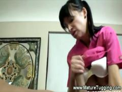 mature-masseuse-gives-a-dirty-tugjob
